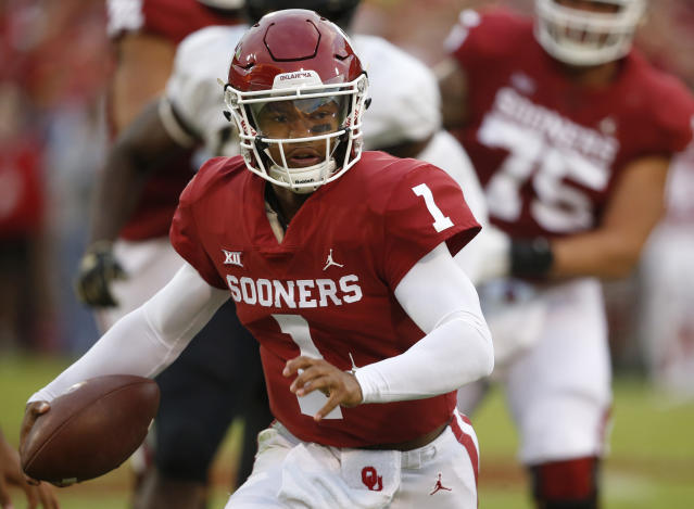 FILE - In this Sept. 22, 2018, file photo, Oklahoma quarterback Kyler Murray (1) carries for a touchdown in the first half of an NCAA college football game against Army, in Norman, Okla. Murray has generated Heisman buzz. The junior has 11 touchdown passes and is second on the team with 240 yards rushing. Baylor plays at Oklahoma on Saturday. (AP Photo/Sue Ogrocki, File)