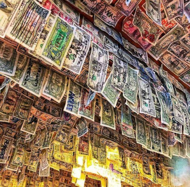 PHOTO: This week, Siesta Key Oyster Bar's general manager Kristin Hale brought a large container of cash to a local Florida bank which counted $13,961. (Siesta Key Oyster Bar/Kristin Hale)