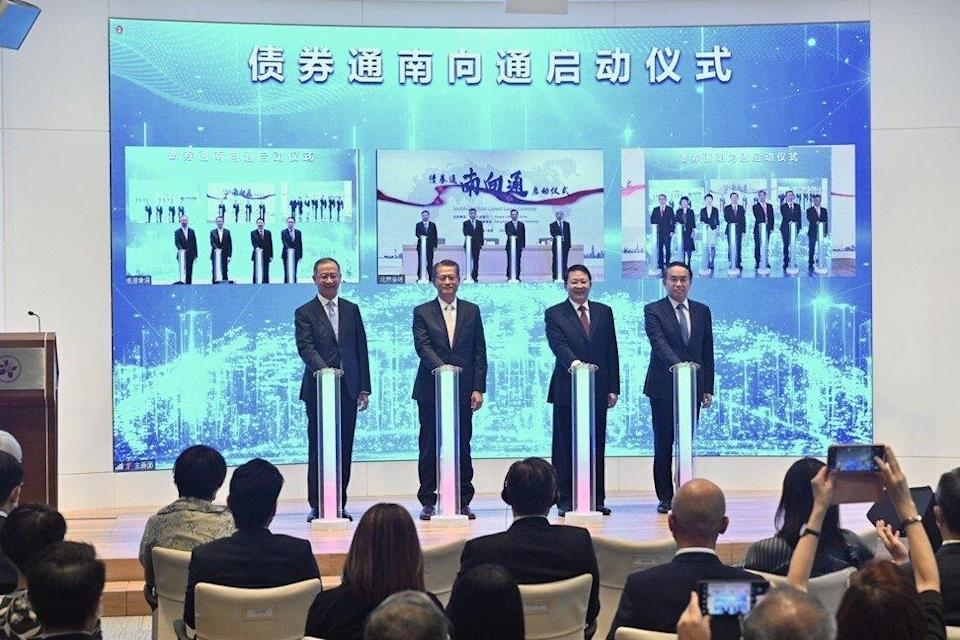 (From left) Hong Kong Monetary Authority CEO Eddie Yue, Financial Secretary Paul Chan, Liaison Office of the Central People's Government in the Hong Kong Special Administrative Region Deputy Director Yin Zonghua and Secretary for Financial Services and the Treasury Christopher Hui attend the launch ceremony of the southbound Bond Connect on Friday. Photo: Handout