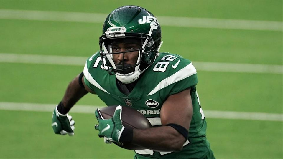 Jamison Crowder runs with the ball in green Jets jersey
