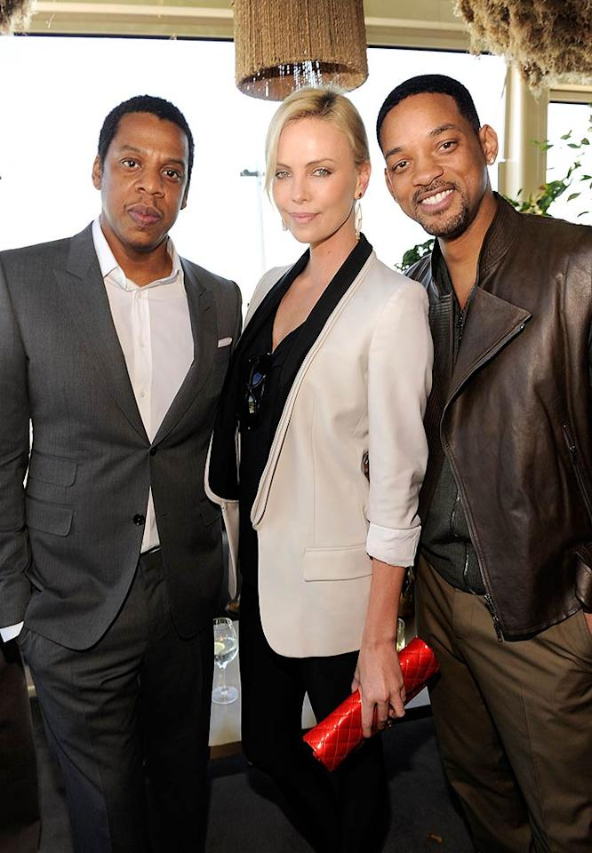 "Of course, Beyonce's hubby, Jay-Z, was also in attendance at the afternoon bash, where he caught up with Charlize Theron and Will Smith. (Jay-Z founded Roc Nation, which is a management, music publishing, and entertainment company.) Kevin Mazur/<a href=""http://www.wireimage.com"" target=""new"">WireImage.com</a> - February 12, 2011"
