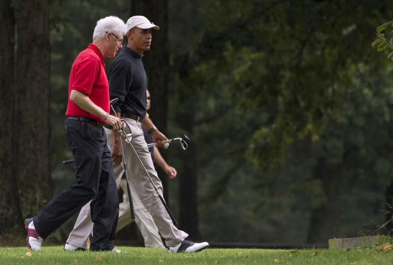 FILE - In this Sept. 24, 2011, file photo President Barack Obama, right, and former President Bill Clinton talk during a game of golf at Andrews Air Force Base, Md. Once a tense rivalry, the relationship between Obama and Clinton has evolved into a genuine political and policy partnership. For Obama, Clinton is a fundraising juggernaut, a powerful reminder to voters that a Democrat ran the White House the last time the economy was thriving. (AP Photo/Evan Vucci, File)