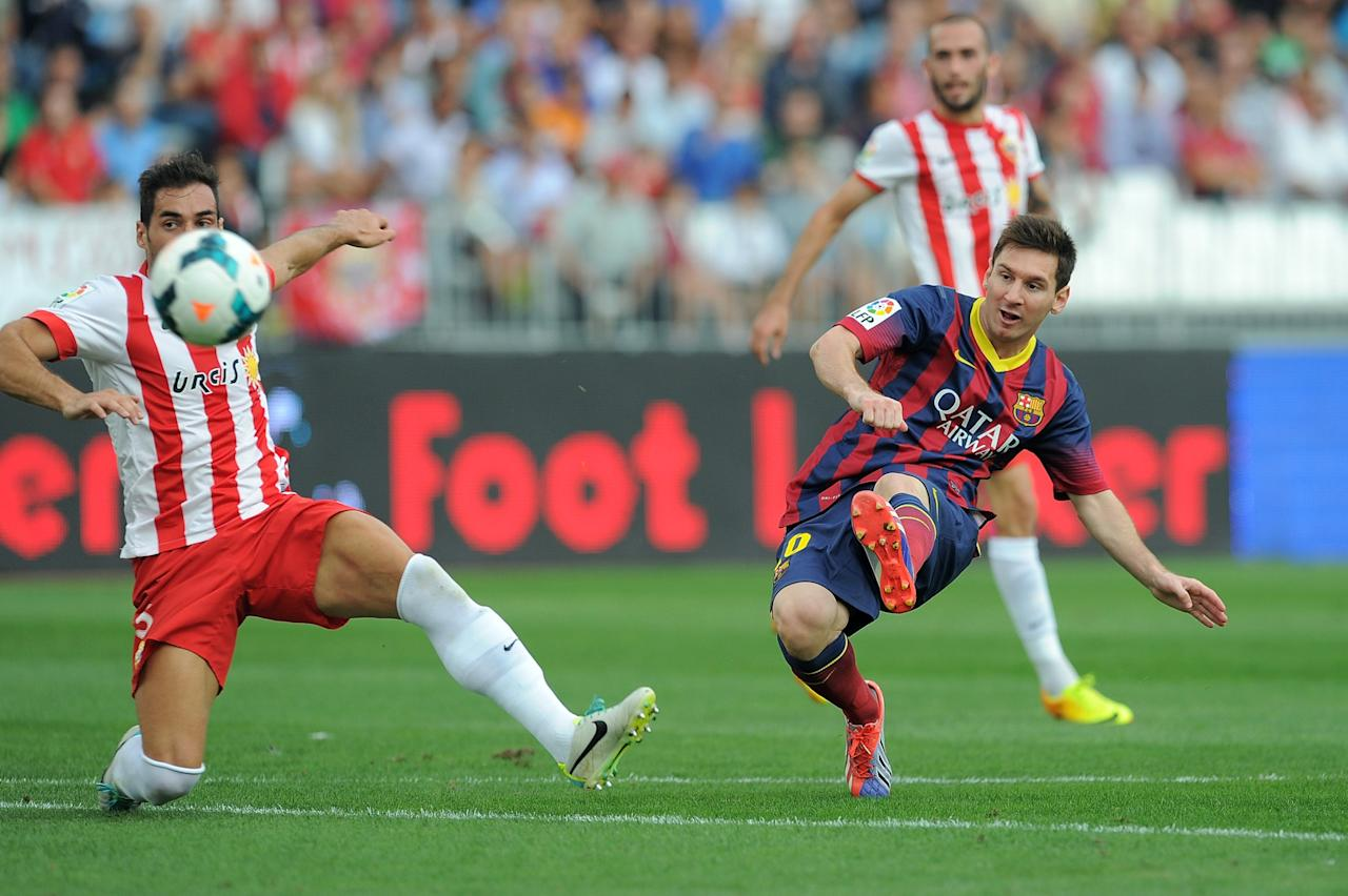 ALMERIA, SPAIN - SEPTEMBER 28: Lionel Messi scores FC Barcelona's opening goal during the La Liga match between UD Almeria and FC Barcelona on September 28, 2013 in Almeria, Spain. (Photo by Denis Doyle/Getty Images)