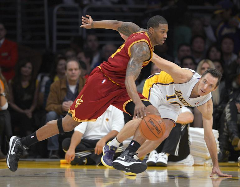 Cleveland Cavaliers forward Alonzo Gee, left, drives toward the basket as Los Angeles Lakers guard Steve Nash defends during the first half of an NBA basketball game, Sunday, Jan. 13, 2013, in Los Angeles. (AP Photo/Mark J. Terrill)
