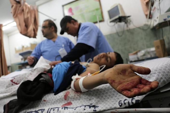 Medics treat a wounded Palestinian at Rafah hospital in the southern Gaza Strip on February 17, 2018 (AFP Photo/Said KHATIB)