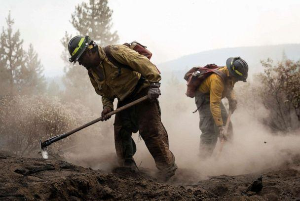 PHOTO: Firefighters from New Mexico work amidst heavy ash and dust to help contain the Bootleg Fire near Silver Lake, Oregon, July 29, 2021. (Maranie Staab/Reuters)