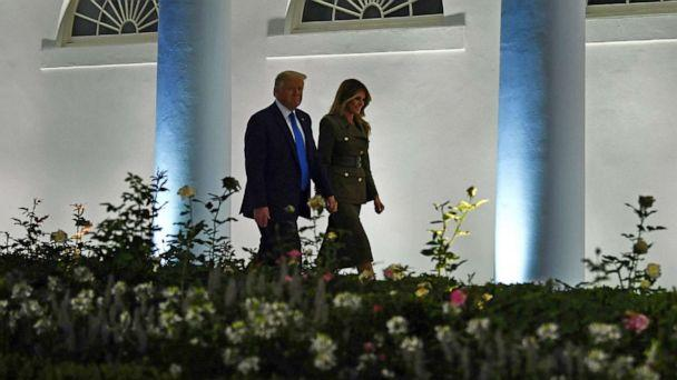 PHOTO: President Donald Trump and first lady Melania Trump walk by the Colonnade before she addresses the Republican Convention during its second day from the Rose Garden of the White House, Aug. 25, 2020, in Washington. (Brendan Smialowski/AFP via Getty Images)