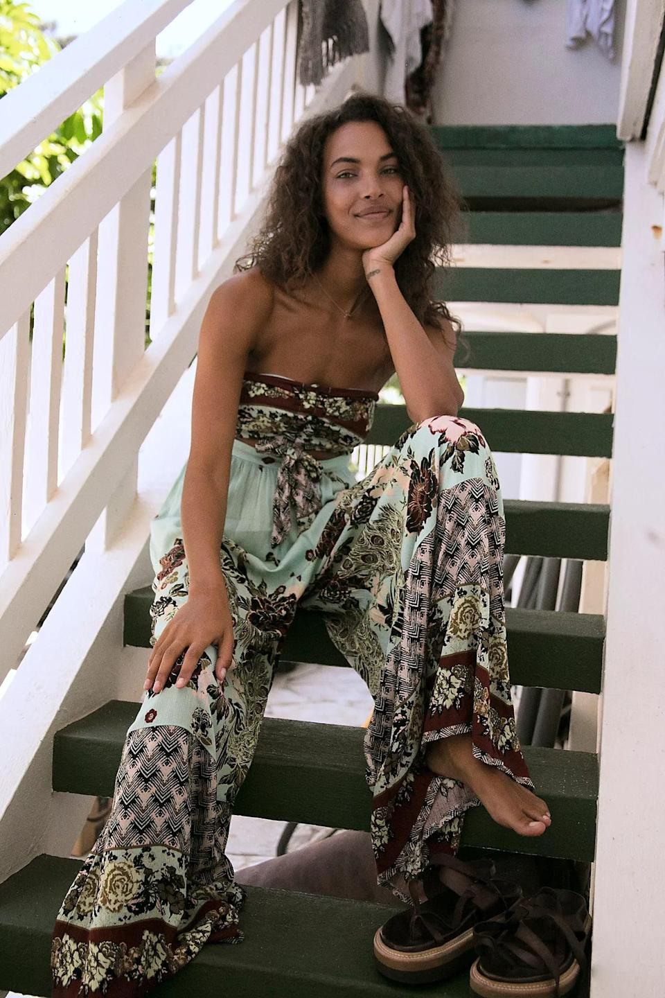 """<p>If you're looking for a printed choice, you can't go wrong with this comfy <a href=""""https://www.popsugar.com/buy/Bali-Birds-Paradise-One-Piece-579191?p_name=Bali%20Birds%20Of%20Paradise%20One%20Piece&retailer=freepeople.com&pid=579191&price=128&evar1=fab%3Aus&evar9=47524904&evar98=https%3A%2F%2Fwww.popsugar.com%2Ffashion%2Fphoto-gallery%2F47524904%2Fimage%2F47525076%2FBali-Birds-Paradise-One-Piece&list1=shopping%2Cjumpsuits%2Cfashion%20shopping%2Crompers%2Ccomfortable%20clothes&prop13=mobile&pdata=1"""" class=""""link rapid-noclick-resp"""" rel=""""nofollow noopener"""" target=""""_blank"""" data-ylk=""""slk:Bali Birds Of Paradise One Piece"""">Bali Birds Of Paradise One Piece</a> ($128).</p>"""