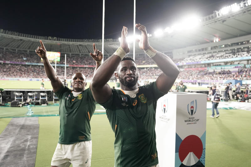 South Africa's Siya Kolisi, center, and Bongi Mbonambi celebrate after defeating Japan in the Rugby World Cup quarterfinal match in Tokyo, Sunday, Oct. 20, 2019. (AP Photo/Jae C. Hong)