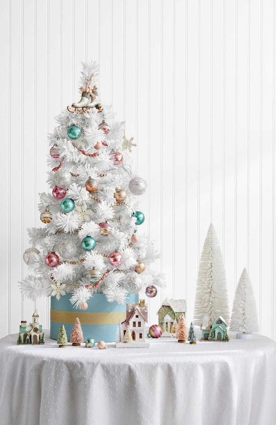 "<p>Sure, the sparkling snowflakes, pastel baubles, and ice-skate topper on this tree are lovely. But we're most drawn to the DIY tree stand here: a simple hatbox. Talk about old-fashioned glamour!</p><p><a class=""link rapid-noclick-resp"" href=""https://www.amazon.com/Darice-Paper-Mache-Craft-Boxes/dp/B001K7N1IA/ref=sr_1_41?tag=syn-yahoo-20&ascsubtag=%5Bartid%7C10050.g.28746492%5Bsrc%7Cyahoo-us"" rel=""nofollow noopener"" target=""_blank"" data-ylk=""slk:SHOP HATBOXES"">SHOP HATBOXES</a></p>"