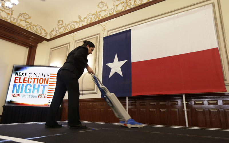 File - In this Nov. 6, 2012 file photo, Marta Rangel Medel vacuums the stage in preparation for the Texas Democratic Party election watch party, in Austin, Texas. Attorney General Eric Holder says Texas is the first place that he will intervene to defend against what he calls attacks on the voting rights of minorities, but it is also the only state where the federal government has a clear opportunity to get involved, experts say. (AP Photo/Eric Gay, File)