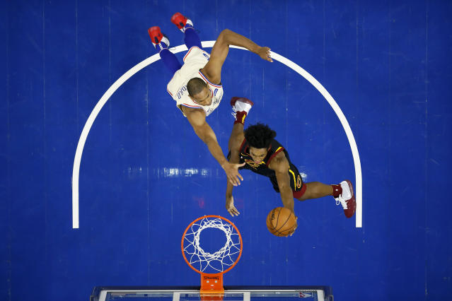 Cleveland Cavaliers' Collin Sexton, right, goes up for a shot against Philadelphia 76ers' Al Horford during the first half of an NBA basketball game, Saturday, Dec. 7, 2019, in Philadelphia. (AP Photo/Matt Slocum)