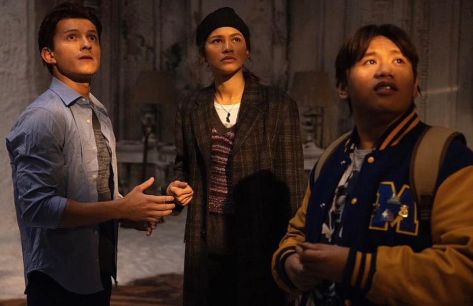 Peter Parker, MJ, and Ned Leeds in a room with light on their faces