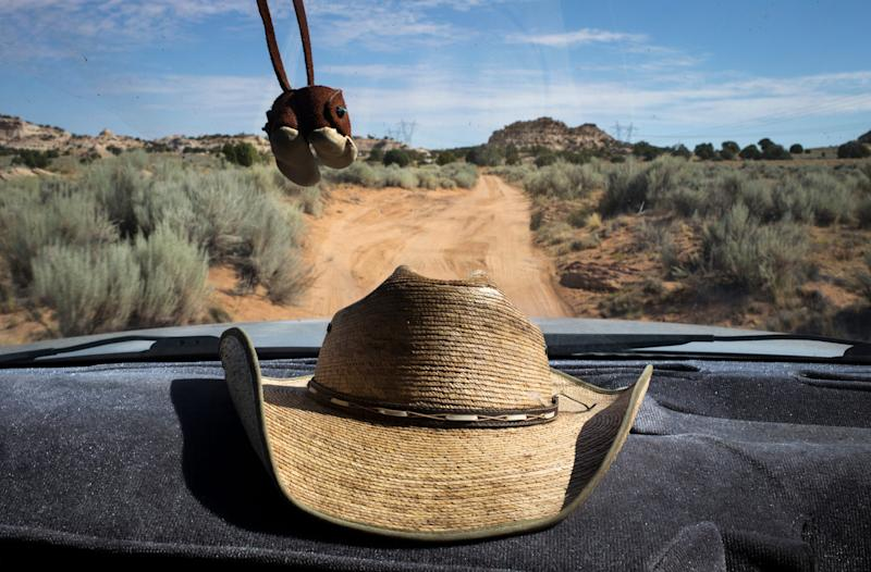 Michael Bigman drives back to his sheep corral on Sept. 6, 2019, in Coppermine, Arizona.