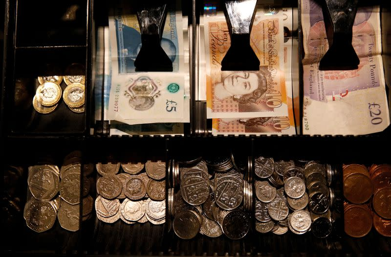 FILE PHOTO: Pound Sterling notes and change are seen inside a cash resgister in a coffee shop in Manchester