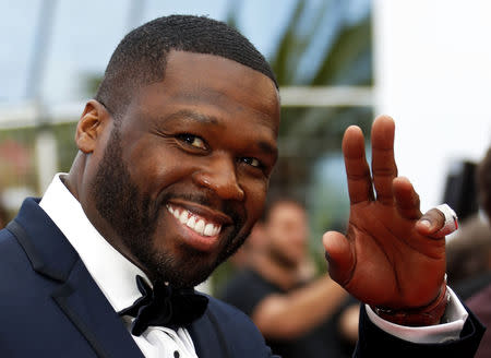 """FILE PHOTO - 71st Cannes Film Festival - Screening of the film """"Solo: A Star Wars Story"""" out of competition - Red Carpet Arrivals - Cannes, France May 15, 2018. 50 Cent poses. REUTERS/Eric Gaillard"""
