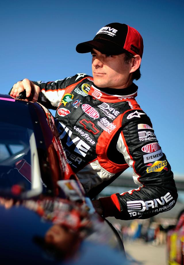 FORT WORTH, TX - NOVEMBER 04: Jeff Gordon, driver of the #24 Drive to End Hunger Chevrolet, climbs from his car after qualifying for the NASCAR Sprint Cup Series AAA Texas 500 at Texas Motor Speedway on November 4, 2011 in Fort Worth, Texas. (Photo by Jared C. Tilton/Getty Images for NASCAR)