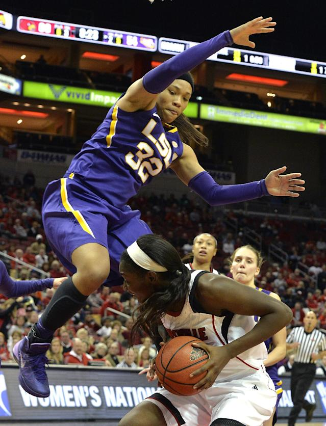 LSU's Danielle Ballard, top, attempts to defend against the shot of Louisville's Asia Taylor during the second half of an NCAA college basketball game on Thursday, Nov. 14, 2013, in Louisville, Ky. Louisville defeated LSU 88-67. (AP Photo/Timothy D. Easley)
