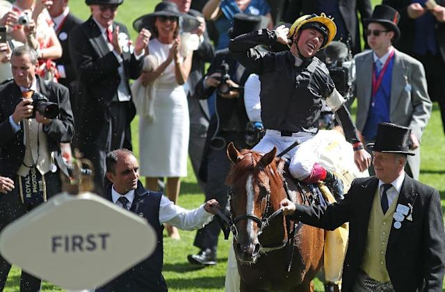 Jockey Frankie Dettori reacts after riding on the horse Stradivarius to win the Gold Cup on Ladies Day at the Royal Ascot horse racing meet, in Ascot, west of London, on June 21, 2018 (AFP Photo/Daniel LEAL-OLIVAS)