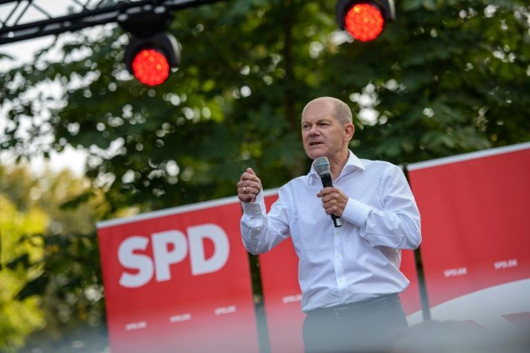 Scholz was caught out on the campaign trail in June for not knowing the price of petrol (AFP/JENS SCHLUETER)