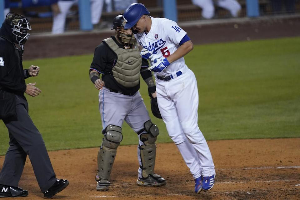 The Dodgers' Corey Seager reacts after being hit with a pitch by Miami Marlins reliever Ross Detwiler in the fifth inning.