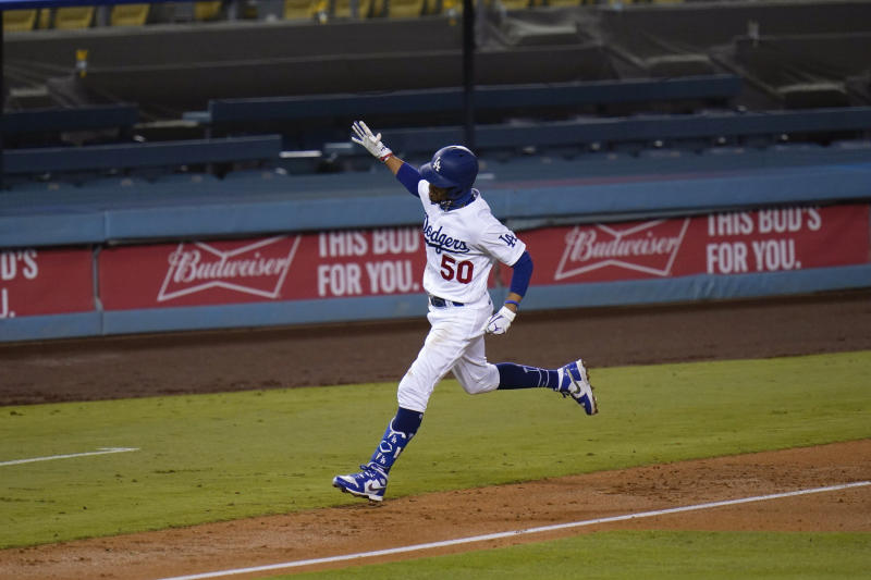 Los Angeles Dodgers' Mookie Betts celebrates his third home run of the game during the fifth inning of a baseball game against the San Diego Padres, Thursday, Aug. 13, 2020, in Los Angeles. (AP Photo/Jae C. Hong)