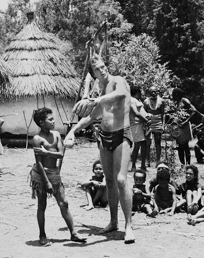 """Ron Ely in August 1966 on the set of """"Tarzan,"""" teaching kids baseball in a remote Mexican village that was the set for an African village in the TV series."""
