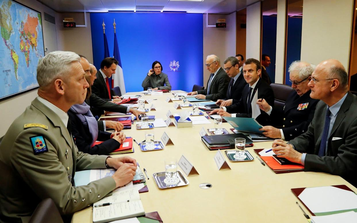French President Emmanuel Macron (centre, right) attends a Defence Council meeting at the Elysee Palace in Paris - REUTERS