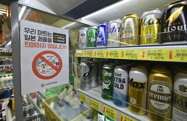 Patriotic South Korean beer drinkers are shunning Japanese brews as a trade row with Tokyo worsens (AFP Photo/Jung Yeon-je)