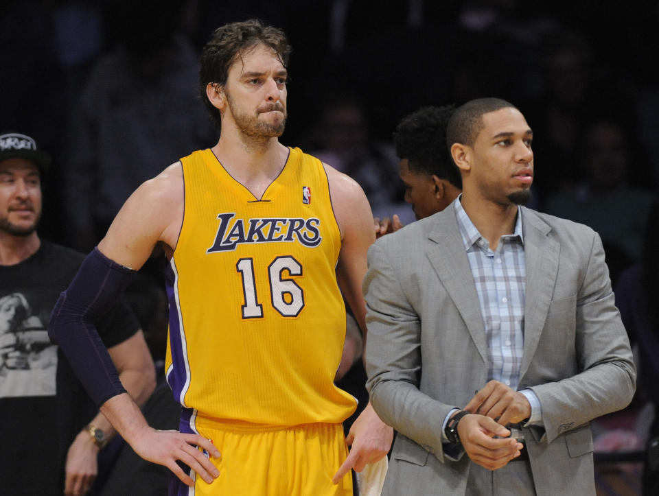 LOS ANGELES, CA - JANUARY 28: The Lakers' Pau Gasol and Xavier Henry don't look happy after the Lakers' 104-92 loss to the Indiana Pacers at Staples Center Tuesday night.    ///ADDITIONAL INFO:       lakers.0129.kjs  ---  Photo by KEVIN SULLIVAN / Orange County Register  --  1/28/14     The Los Angeles Lakers take on the Indiana Pacers at Staples Center Tuesday night.    1/28/14      (Photo by Kevin Sullivan/Digital First Media/Orange County Register via Getty Images)