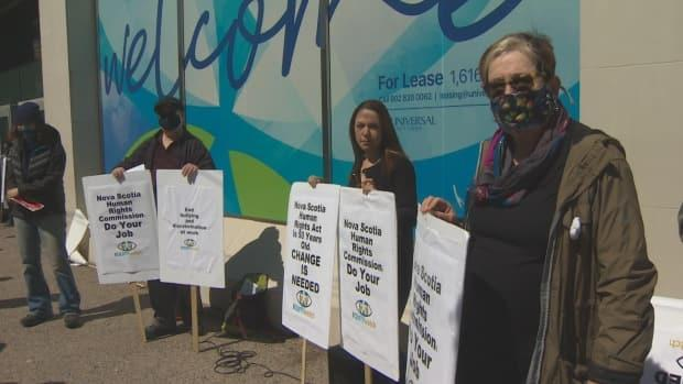 Members of Equity Watch, a group that keeps tabs on the Nova Scotia Human Rights Commission, protests the dismissal of a sexual harassment complaint on April 8, 2021.