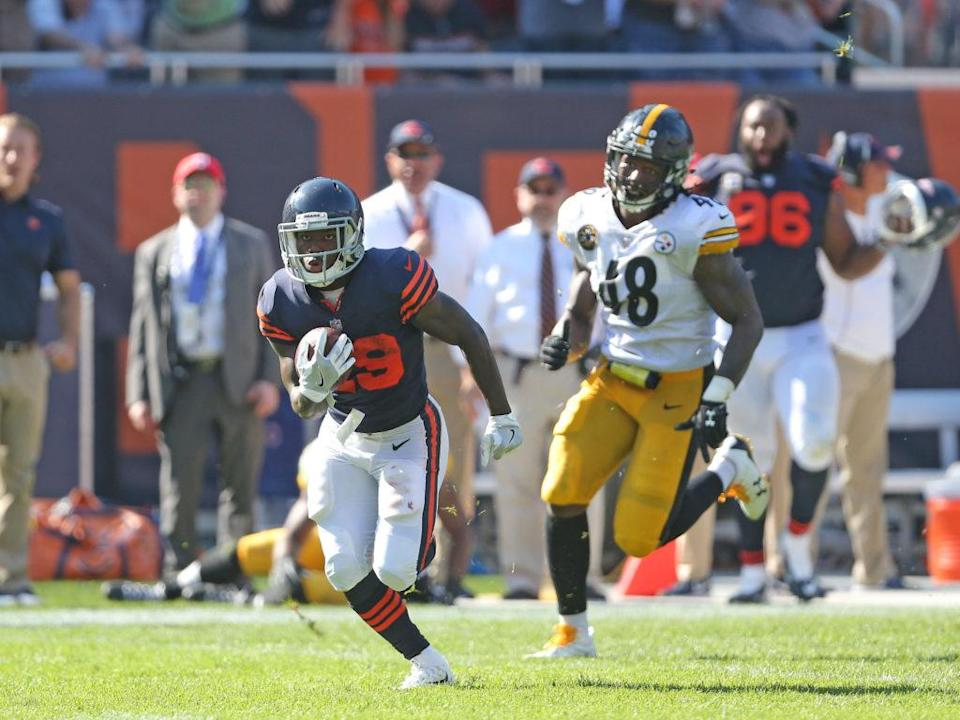 Sep 24, 2017; Chicago, IL, USA; Chicago Bears running back Tarik Cohen (29) runs for 36 yards during the overtime period and is chased by Pittsburgh Steelers outside linebacker Bud Dupree (48) at Soldier Field. Chicago won 23-17 in OT. Mandatory Credit: Dennis Wierzbicki-USA TODAY Sports