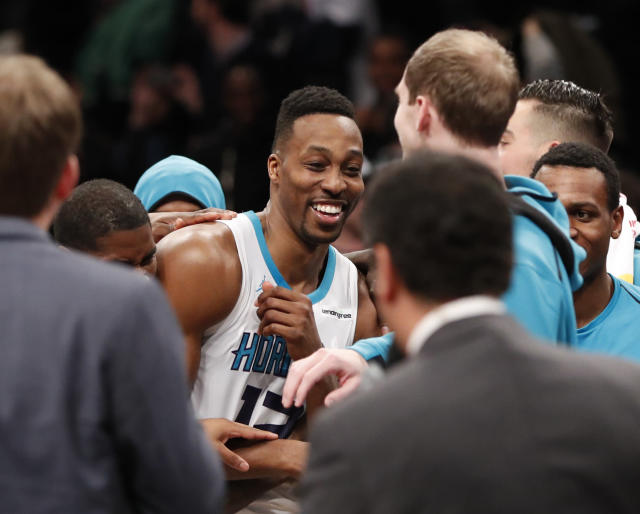 Dwight Howard celebrates after his historic 32-point, 30-rebound night in a Hornets win over the Brooklyn Nets. (AP)