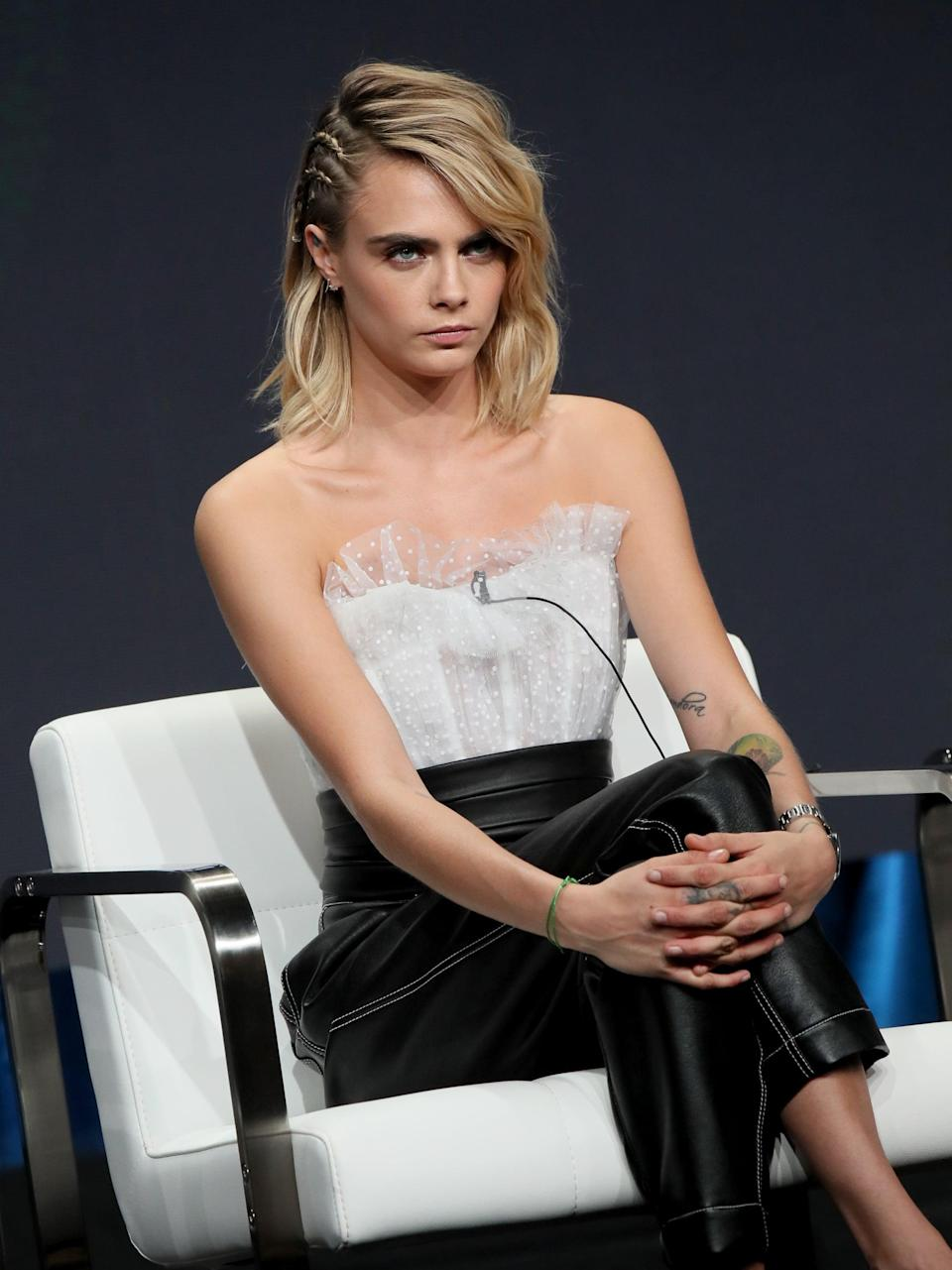 <p>One of Delevingne's favorite hairstyles is taking a simple wavy lob and turning it into an intricate braided work of art. She did exactly that for a <strong>Carnival Row</strong> conference with double side braids above one ear.</p>