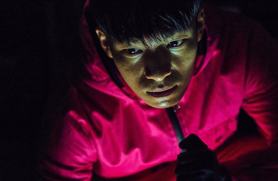 """The young actor, playing the motivated police officer who crashes the game in pursuit of his brother, starred in several Korean films, including 'Romance Is a Bonus Book'. He is known in Korean mainly for his work in rom-coms. He said he enjoyed his role in the Netflix hit, in an attempt to transition to something """"a bit more serious"""". He said: """"I'm a fan of the darker genres, so the transition to Squid Game was the time for me to take advantage of my strengths."""" He also revealed that he used to watch the movie 'New World' starring his co-star, Lee Jung-jae, over 30 times when he was in the military."""