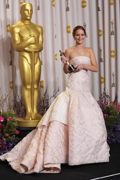 """Jennifer Lawrence poses with her award for best actress in a leading role for """"Silver Linings Playbook"""" during the Oscars at the Dolby Theatre on Sunday Feb. 24, 2013, in Los Angeles. (Photo by John Shearer/Invision/AP)"""