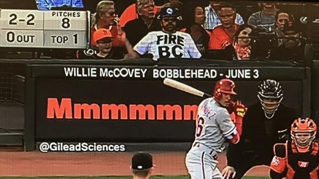"A fan at a Philadelphia Phillies game in San Francisco on Friday night wore a ""Fire BC"" shirt behind home plate, expertly trolling 76ers president of basketball operations Bryan Colangelo over his alleged use of multiple Twitter accounts. (@JClarkNBCS/Twitter)"