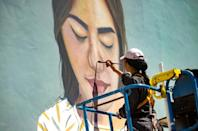 """Imane Droby, a female street artist who also took part in the festival, says women have to """"double the effort"""" to make their mark (AFP/FADEL SENNA)"""