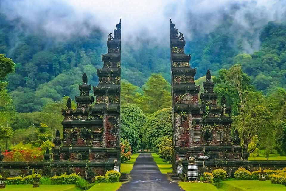 """<a href=""""https://www.cntraveler.com/destinations/bali?mbid=synd_yahoo_rss"""" rel=""""nofollow noopener"""" target=""""_blank"""" data-ylk=""""slk:Bali"""" class=""""link rapid-noclick-resp"""">Bali</a> is one of the best places to travel in September, thanks to warm temperatures and virtually no rainfall. (You can also enjoy a slight dip in hotel rates during this time, as it falls just after peak tourist season.) All the better to enjoy the island's famous temples, gardens, monkeys, and surfing beaches. You're spoiled for choice when it comes to regions to explore, from the rain-forested inland district of Ubud to the rice paddies and eclectic shops of Canggu. But we suggest booking your stay at a hotel or resort where you can get the full Bali experience in one stop, like editor- and reader-approved <a href=""""https://www.cntraveler.com/hotels/ubud-gianyar/ubud-gianyar/como-shambhala-estate?mbid=synd_yahoo_rss"""" rel=""""nofollow noopener"""" target=""""_blank"""" data-ylk=""""slk:COMO Shambhala Estate"""" class=""""link rapid-noclick-resp"""">COMO Shambhala Estate</a>, a five-star refuge for luxury travelers seeking spiritual development with Hindu water blessings and chakra healers. With its three pools, private waterfall, nutritious Southeast Asian food, and hammam spa, you're guaranteed to leave feeling better than when you arrived. (Right now, Bali's government is hoping to open up to tourists in either late July or early August.)"""