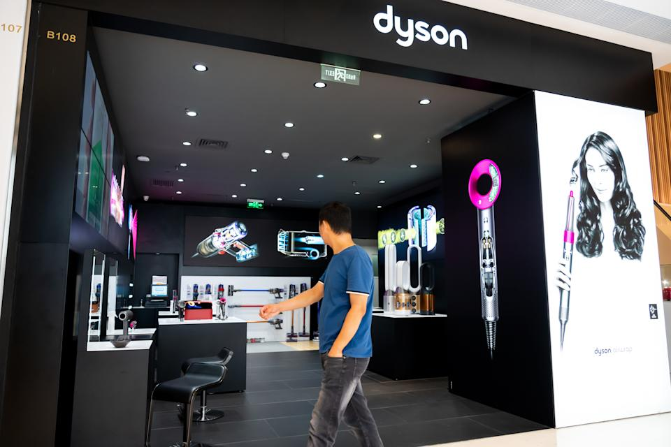 SHENZHEN, GUANGDONG, CHINA - 2019/10/05: Pedestrian walk past a British technology company Dyson store in Shenzhen. (Photo by Alex Tai/SOPA Images/LightRocket via Getty Images)