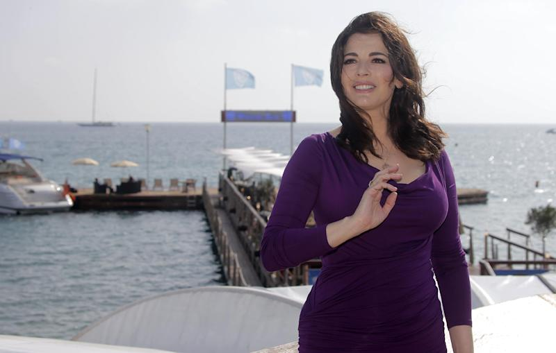 "FILE - In this Oct. 9, 2012 file photo, English food writer, journalist and broadcaster, Nigella Lawson poses during the 28th MIPCOM (International Film and Programme Market for Tv, Video,Cable and Satellite) in Cannes, southeastern France. With a new cookbook, ""Nigellissima,"" coming on the heels of a new celebrity-rich reality food television show on ABC, the English food star seems intent on leaving a larger mark on the American culinary scene. (AP Photo/Lionel Cironneau, File )"