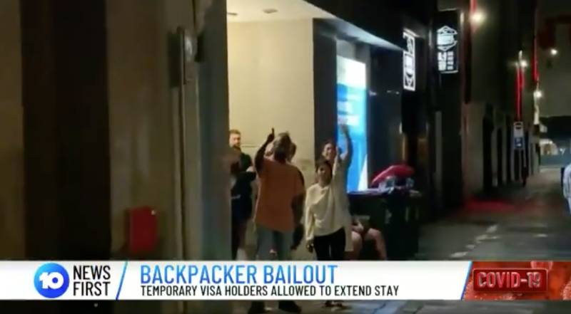 Some backpackers are pictured outside a hostel waving and flashing a thumbs up. Source: 10 News First