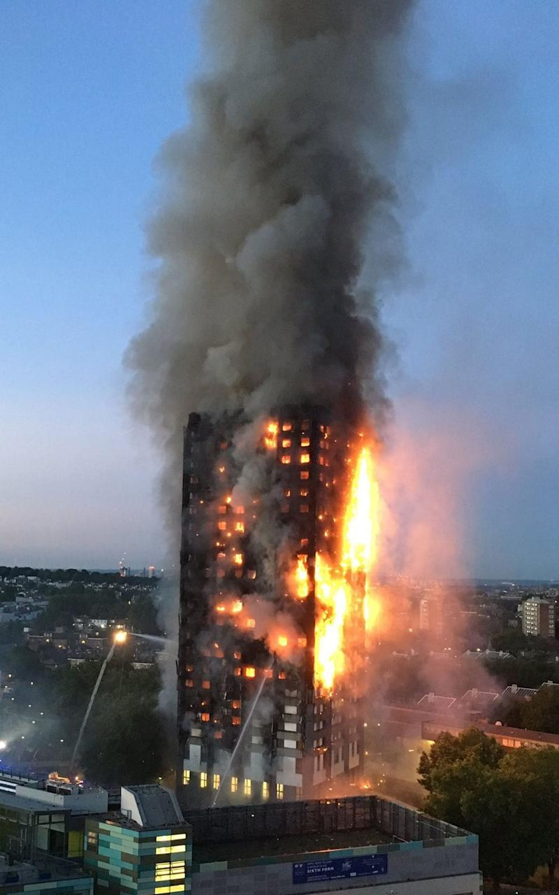 Grenfell Tower flames - Credit: NATALIE OXFORD/AFP