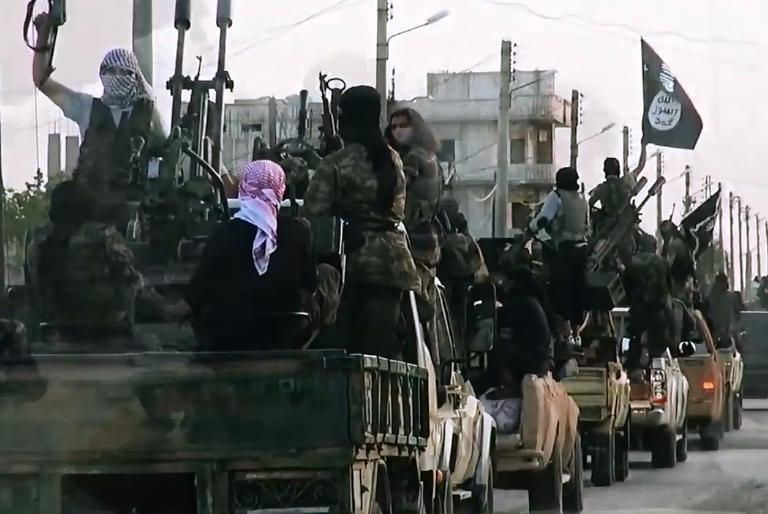 An image grab taken from a propaganda video released on March 17, 2014 by the Islamic State (IS)'s al-Furqan Media allegedly shows the group's fighters driving through the northern Syrian City of Homs