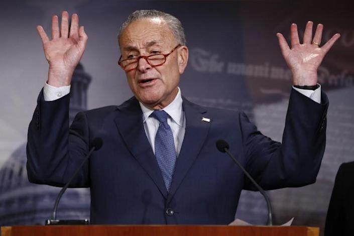 Senate minority leader, Charles Schumer, D-NY., gestures during a news conference in the Senate media room at the Capitol Tuesday, Jan. 21, 2020, in Washington. (AP Photo/Steve Helber)