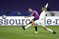 Paris Saint Germain's Angel Di Maria, left, challenges for the ball with Lyon's Jason Denayer, right, during the French League One soccer match between Lyon and PSG in Decines, near Lyon, central France, Sunday, March 21, 2021. (AP Photo/Laurent Cipriani)