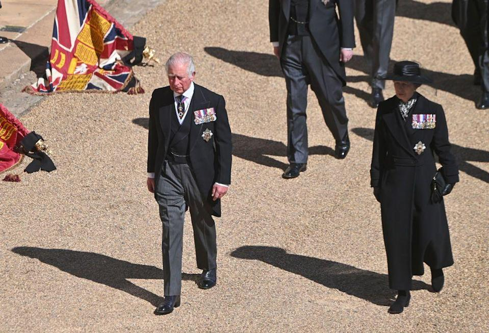 <p>Prince Charles and Princess Anne walk in the procession. </p>