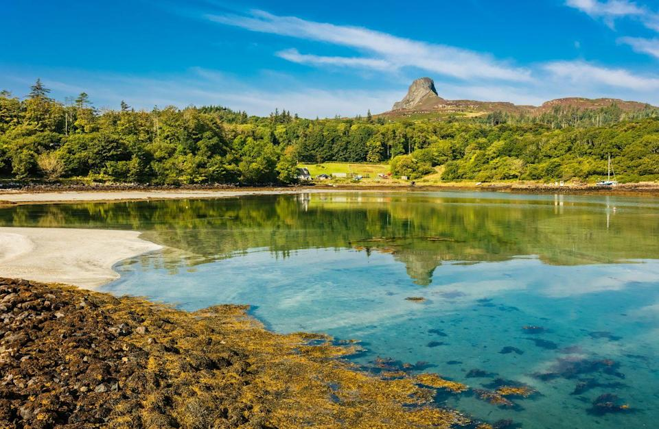 """<p>With its lush scenery and crystal-clear water, there's something exotic about this photo of Eigg.</p><p><a class=""""link rapid-noclick-resp"""" href=""""https://www.countrylivingholidays.com/tours/scotland-hebrides-islands-islay-mull-cruise"""" rel=""""nofollow noopener"""" target=""""_blank"""" data-ylk=""""slk:VISIT THE ISLE OF EIGG WITH CL"""">VISIT THE ISLE OF EIGG WITH CL</a></p>"""