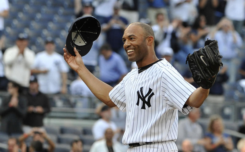 FILE - In this Sept, 19, 2011 file photo, New York Yankees closer Mariano Rivera acknowledges the cheers of the crowd after recording his 602nd career save, after the Yankees beat the Minnesota Twins 6-4 in a baseball game at Yankee Stadium in New York. A person familiar with the decision says that Rivera plans to retire after the 2013 season. The person spoke to The Associated Press on Thursday, March 7, 2013, on condition of anonymity because there had been no official announcement. (AP Photo/Kathy Kmonicek, File)