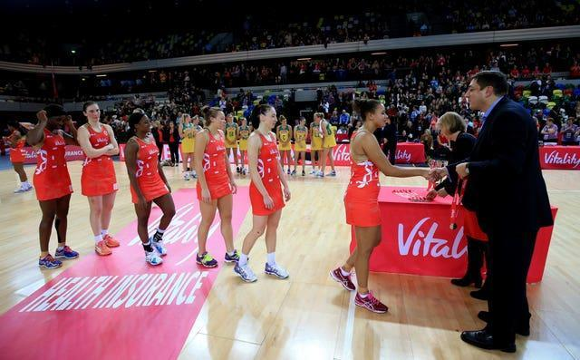 England's Laura Malcolm receives her series medal at the Copper Box